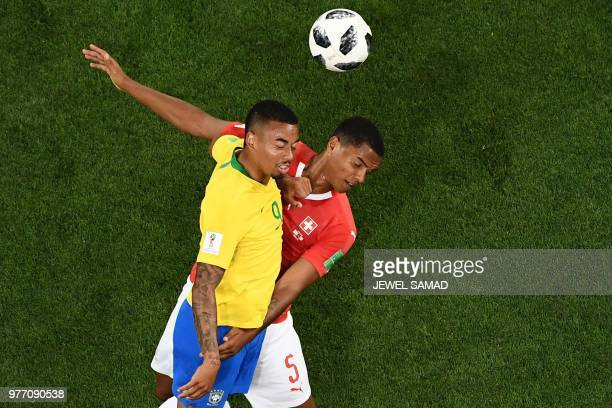TOPSHOT Brazil's forward Gabriel Jesus vies with Switzerland's defender Manuel Akanji during the Russia 2018 World Cup Group E football match between...