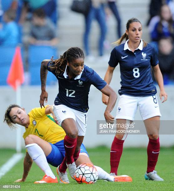 Brazil's forward Gabriela Demoner vies for the ball with France's midfielder Elodie Thomis during the Women's friendly football match France versus...