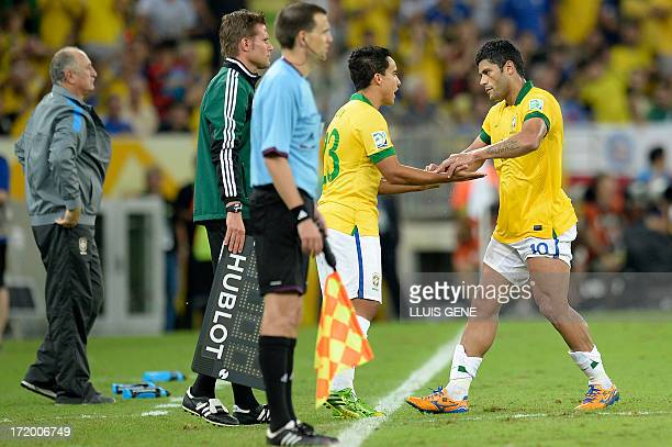 Brazil's forward Hulk is replaced by Brazil's forward Jadson during their FIFA Confederations Cup Brazil 2013 final football match against Spain at...