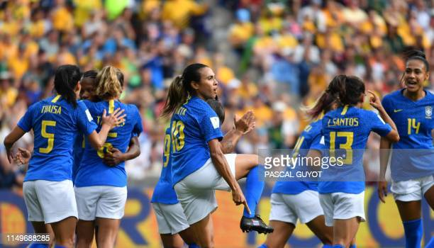 Brazil's forward Marta celebrates after scoring penalty kick during the France 2019 Women's World Cup Group C football match between Australia and...