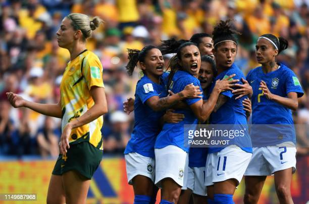 Brazil's forward Marta celebrates with teammates after scoring a penalty kick during the France 2019 Women's World Cup Group C football match between...