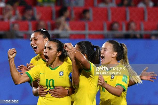 Brazil's forward Marta is congratulated by teammates after scoring a goal during the France 2019 Women's World Cup Group C football match between...