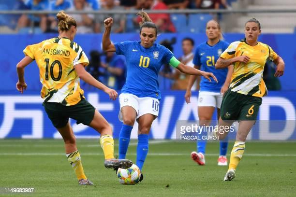 Brazil's forward Marta vies for the ball with Australia's midfielder Emily Van Egmond and Australia's midfielder Chloe Logarzo during the France 2019...