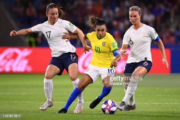 TOPSHOT Brazil's forward Marta vies with France's midfielder Gaetane Thiney and France's midfielder Amandine Henry during the France 2019 Women's...