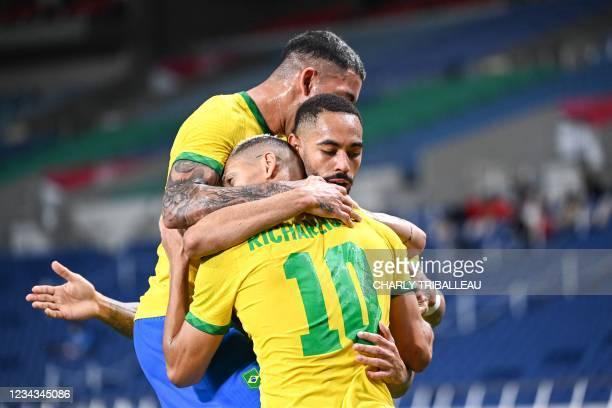 Brazil's forward Matheus Cunha celebrates with teammates after scoring a goal during the Tokyo 2020 Olympic Games men's quarter-final football match...