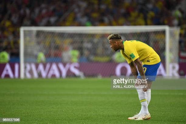 Brazil's forward Neymar adjusts his socks during the Russia 2018 World Cup Group E football match between Serbia and Brazil at the Spartak Stadium in...
