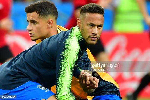 Brazil's forward Neymar and Brazil's forward Philippe Coutinho warm up prior to the Russia 2018 World Cup quarterfinal football match between Brazil...