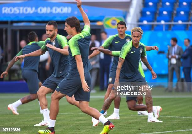 Brazil's forward Neymar and teammates take part in a training session at the Rostov Arena in RostovonDon on June 16 2018 on the eve of the Russia...