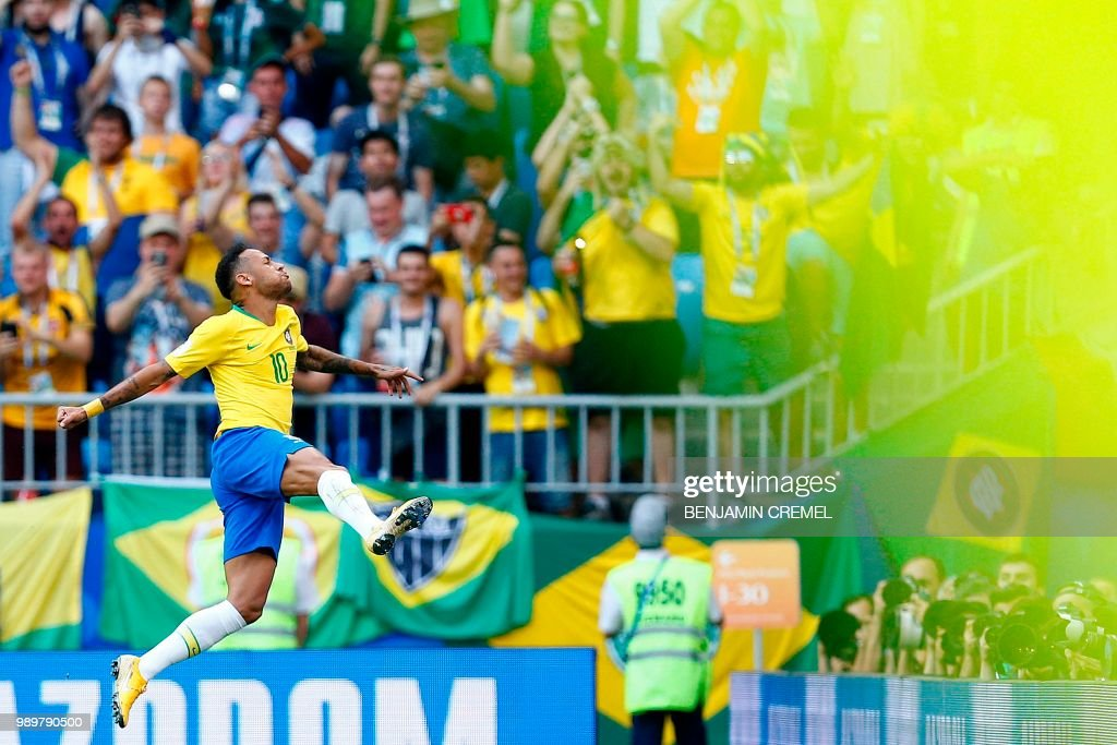 Brazil's forward Neymar celebrates a goal during the Russia 2018 World Cup round of 16 football match between Brazil and Mexico at the Samara Arena in Samara on July 2, 2018. (Photo by BENJAMIN CREMEL / AFP) / RESTRICTED