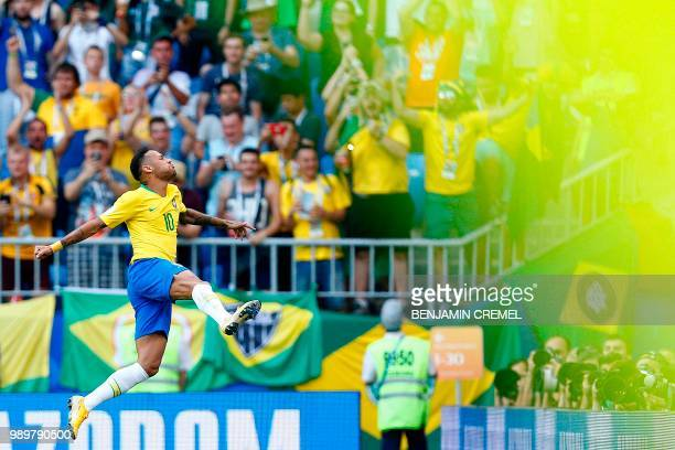 Brazil's forward Neymar celebrates a goal during the Russia 2018 World Cup round of 16 football match between Brazil and Mexico at the Samara Arena...