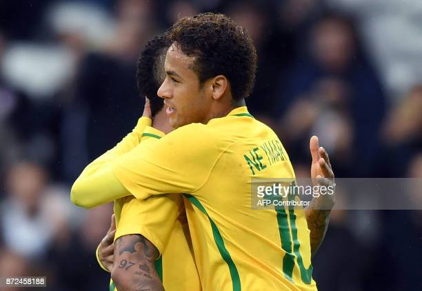 Brazil's forward Neymar celebrates after scoring a goal during the football match between Brasil and Japan at the PierreMauroy Stadium in Villeneuve...