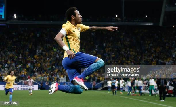 TOPSHOT Brazil's forward Neymar celebrates after scoring against Paraguay during their 2018 FIFA World Cup qualifier football match in Sao Paulo...