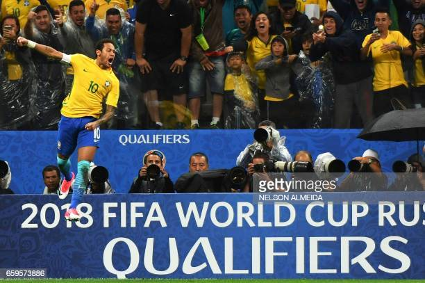 Brazil's forward Neymar celebrates after scoring against Paraguay during their 2018 FIFA World Cup qualifier football match in Sao Paulo Brazil on...