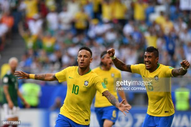 Brazil's forward Neymar celebrates after scoring the opening goal during the Russia 2018 World Cup round of 16 football match between Brazil and...