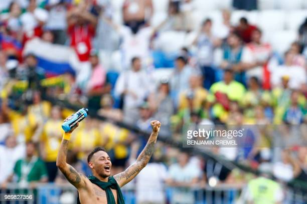 TOPSHOT Brazil's forward Neymar celebrates at the end of the Russia 2018 World Cup round of 16 football match between Brazil and Mexico at the Samara...