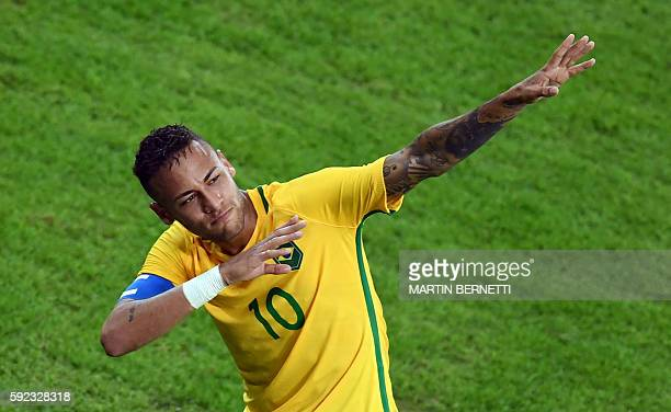 TOPSHOT Brazil's forward Neymar celebrates scoring his team's first goal during the Rio 2016 Olympic Games men's football gold medal match between...