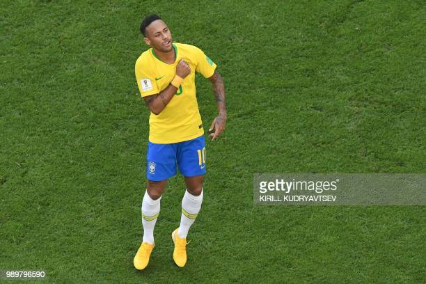 TOPSHOT Brazil's forward Neymar celebrates scoring the opening goal during the Russia 2018 World Cup round of 16 football match between Brazil and...