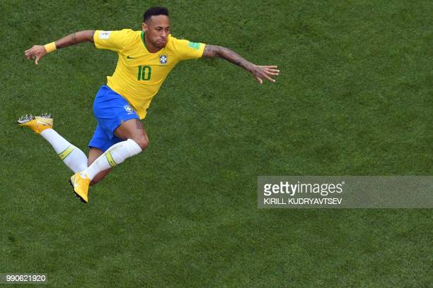 Brazil's forward Neymar celebrates scoring the opening goal during the Russia 2018 World Cup round of 16 football match between Brazil and Mexico at...