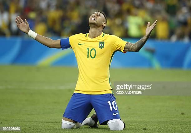 TOPSHOT Brazil's forward Neymar celebrates scoring the winning goal during the penalty shootout of the Rio 2016 Olympic Games men's football gold...