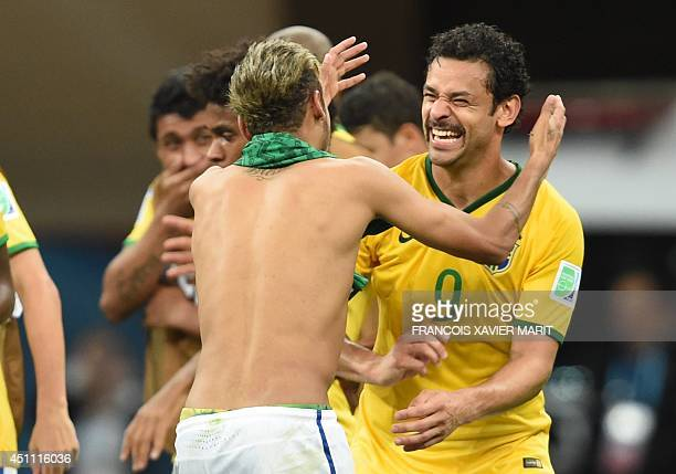 Brazil's forward Neymar celebrates with Brazil's forward Fred at the end of a Group A football match between Cameroon and Brazil at the Mane...