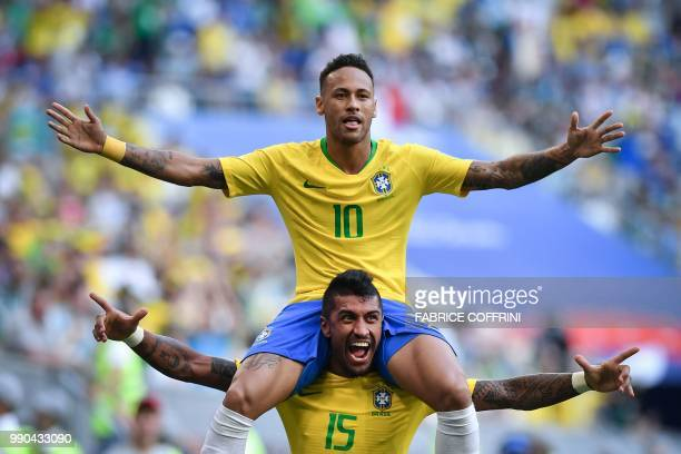 TOPSHOT Brazil's forward Neymar celebrates with Brazil's midfielder Paulinho after scoring the opening goal during the Russia 2018 World Cup round of...