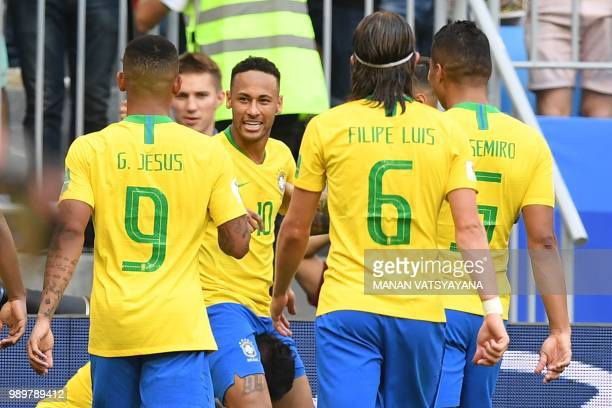Brazil's forward Neymar celebrates with teammates after scoring a goal during the Russia 2018 World Cup round of 16 football match between Brazil and...