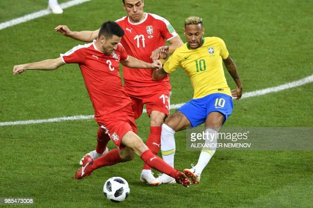 TOPSHOT Brazil's forward Neymar challenges Serbia's forward Filip Kostic and Serbia's defender Antonio Rukavina during the Russia 2018 World Cup...