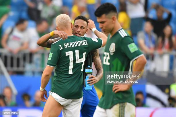 TOPSHOT Brazil's forward Neymar cheers Mexico's forward Javier Hernandez at the end of the Russia 2018 World Cup round of 16 football match between...