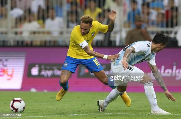 Brazil's forward Neymar drives the ball during the friendly football match Brazil vs Argentina at the King Abdullah Sport City Stadium in Jeddah on...