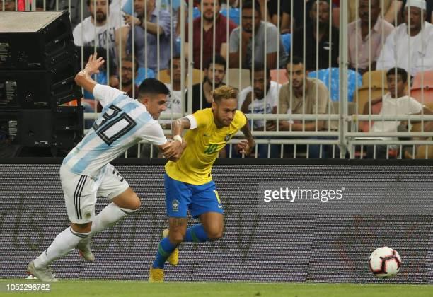 Brazil's forward Neymar drives the ball past Argentina's midfielder Rodrigo Battaglia during the friendly football match Brazil vs Argentina at the...