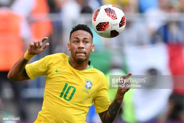 TOPSHOT Brazil's forward Neymar eyes the ball during the Russia 2018 World Cup round of 16 football match between Brazil and Mexico at the Samara...