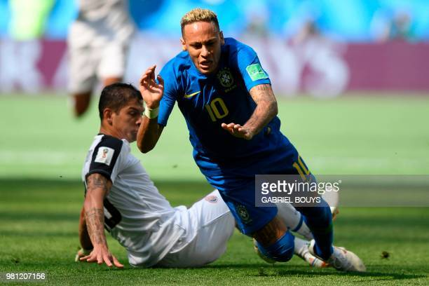 Brazil's forward Neymar falls down after being tackled by Costa Rica's defender Cristian Gamboa during the Russia 2018 World Cup Group E football...