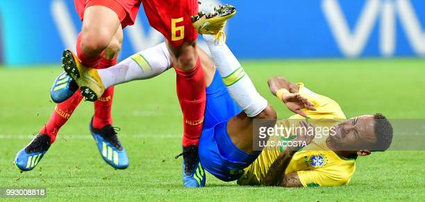TOPSHOT Brazil's forward Neymar falls during the Russia 2018 World Cup quarterfinal football match between Brazil and Belgium at the Kazan Arena in...