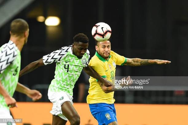 Brazil's forward Neymar fight for the ball with Nigeria's midfielder Wilfred Ndidi during an international friendly football match between Brazil and...