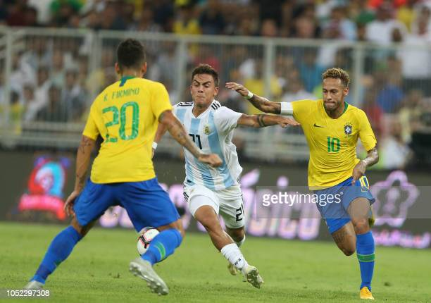 TOPSHOT Brazil's forward Neymar fights for the ball with Argentina's forward Paulo Dybala during the friendly football match Brazil vs Argentina at...