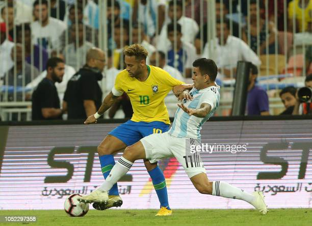 Brazil's forward Neymar fights for the ball with Argentina's forward Angel Correa during the friendly football match Brazil vs Argentina at the King...