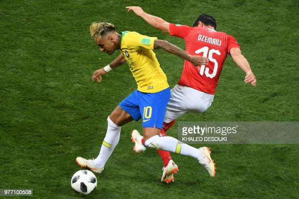 Brazil's forward Neymar fights for the ball with Switzerland's midfielder Blerim Dzemaili during the Russia 2018 World Cup Group E football match...