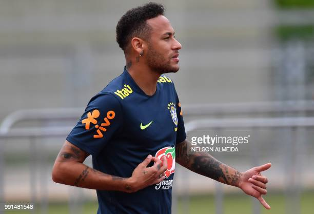 Brazil's forward Neymar gestures during a training session at Yug Sport Stadium in Sochi on July 4 during the Russia 2018 World Cup football...