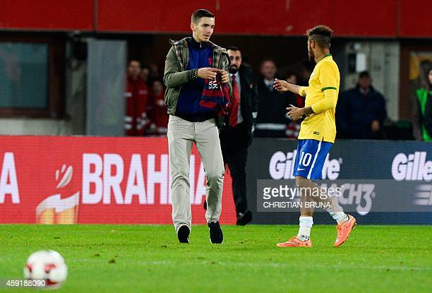 Brazil's forward Neymar goes to sign a shirt for a fan during a friendly football match Austria vs Brazil at the Ernst Happel Stadium in Vienna on...