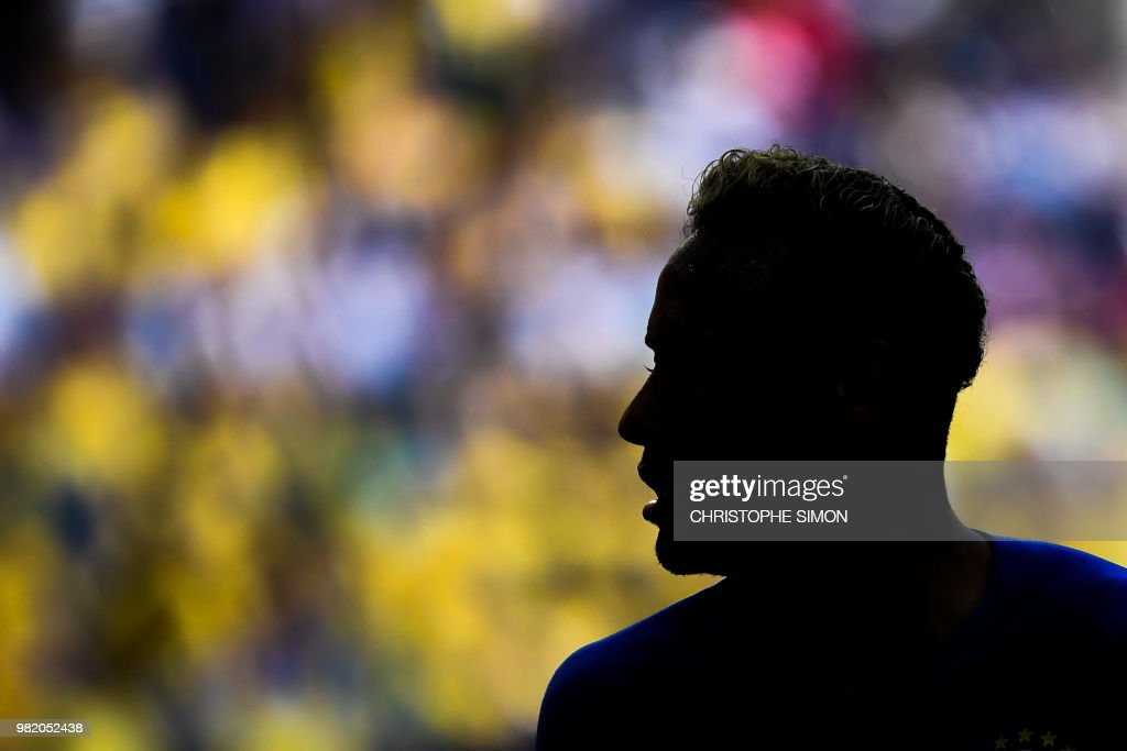 TOPSHOT - Brazil's forward Neymar is silhouetted during the Russia 2018 World Cup Group E football match between Brazil and Costa Rica at the Saint Petersburg Stadium in Saint Petersburg on June 22, 2018.