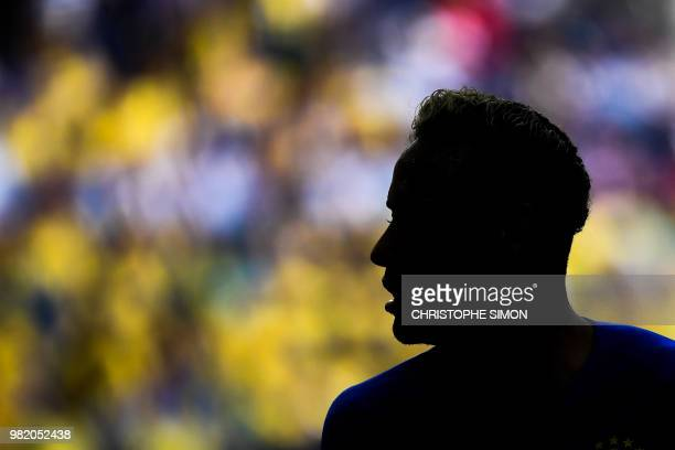 TOPSHOT Brazil's forward Neymar is silhouetted during the Russia 2018 World Cup Group E football match between Brazil and Costa Rica at the Saint...