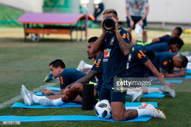 Brazil's forward Neymar jokes with photographers during a training session at the YugSport Stadium in Sochi on June 29 2018 during the Russia 2018...