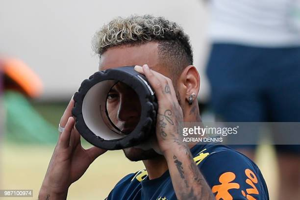 TOPSHOT Brazil's forward Neymar jokes with photographers during a training session at the YugSport Stadium in Sochi on June 29 2018 during the Russia...