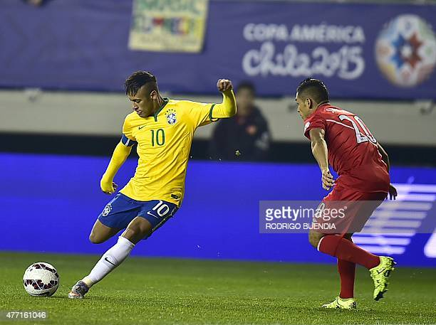 Brazil's forward Neymar kicks the ball marked by Peru's midfielder Joel Sanchez during their 2015 Copa America football championship match in Temuco...