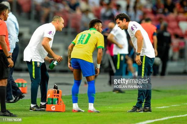 TOPSHOT Brazil's forward Neymar leaves the field during an international friendly football match between Brazil and Nigeria at the National Stadium...
