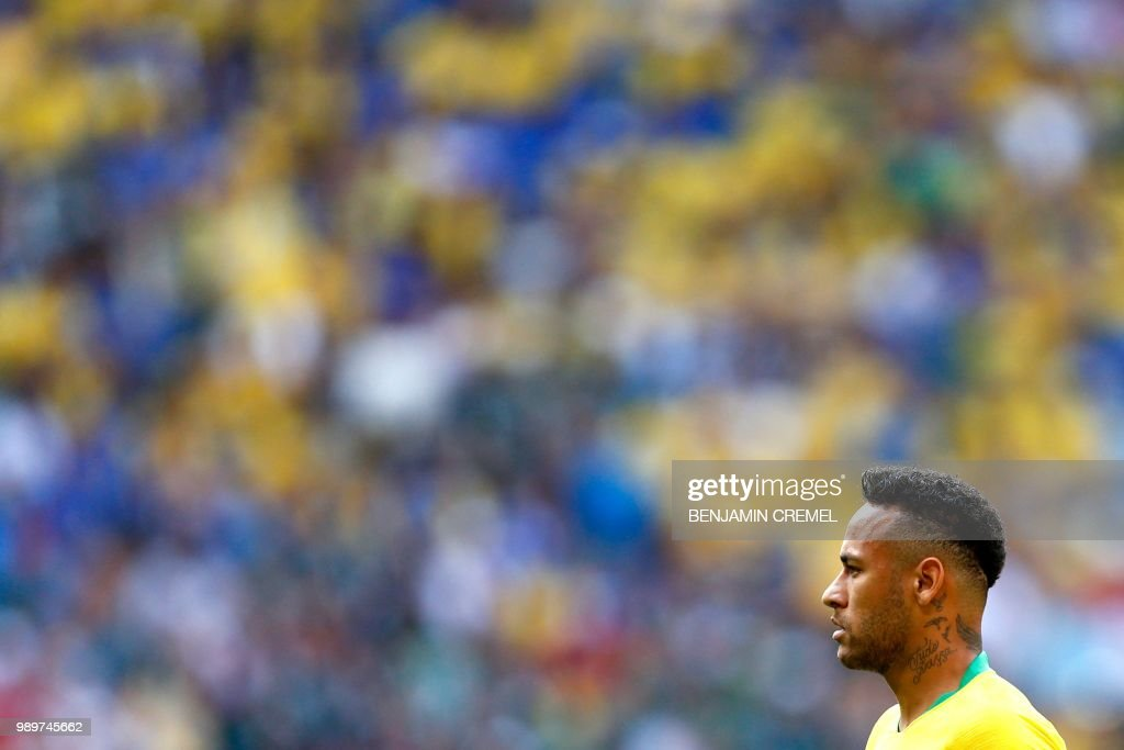 Brazil's forward Neymar listens to the national anthem before the Russia 2018 World Cup round of 16 football match between Brazil and Mexico at the Samara Arena in Samara on July 2, 2018. (Photo by BENJAMIN CREMEL / AFP) / RESTRICTED