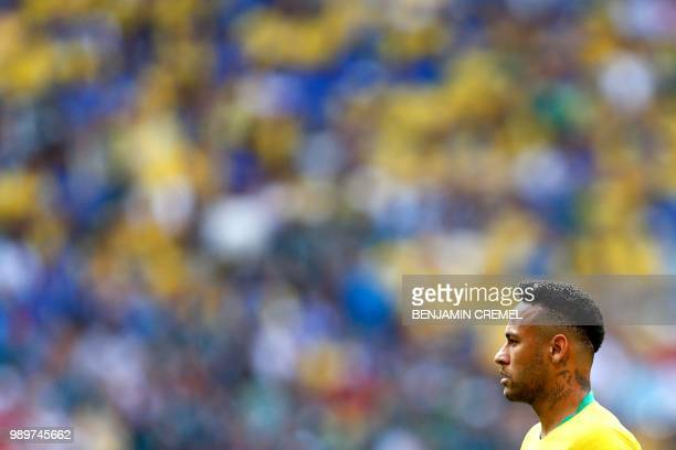 Brazil's forward Neymar listens to the national anthem before the Russia 2018 World Cup round of 16 football match between Brazil and Mexico at the...