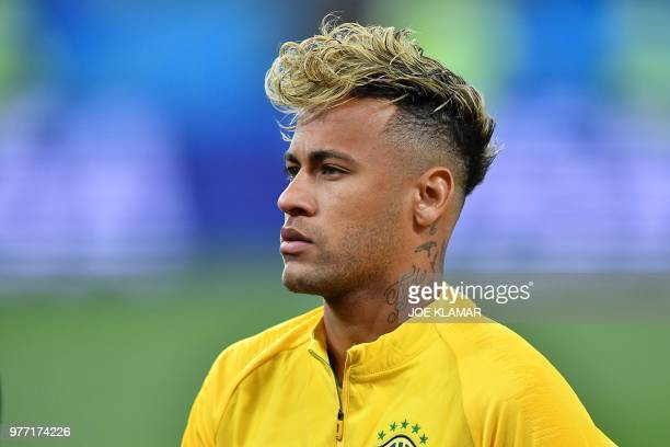 Brazil's forward Neymar looks on before the Russia 2018 World Cup Group E football match between Brazil and Switzerland at the Rostov Arena in...