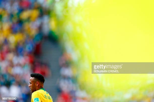 TOPSHOT Brazil's forward Neymar looks on during the Russia 2018 World Cup round of 16 football match between Brazil and Mexico at the Samara Arena in...