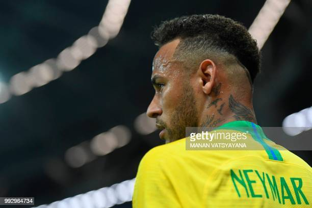 TOPSHOT Brazil's forward Neymar looks on during the Russia 2018 World Cup quarterfinal football match between Brazil and Belgium at the Kazan Arena...